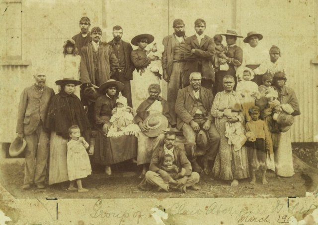 Group of unnamed Aboriginal men women & children at St Clair near Singleton, first AIM station 1903. SLNSW