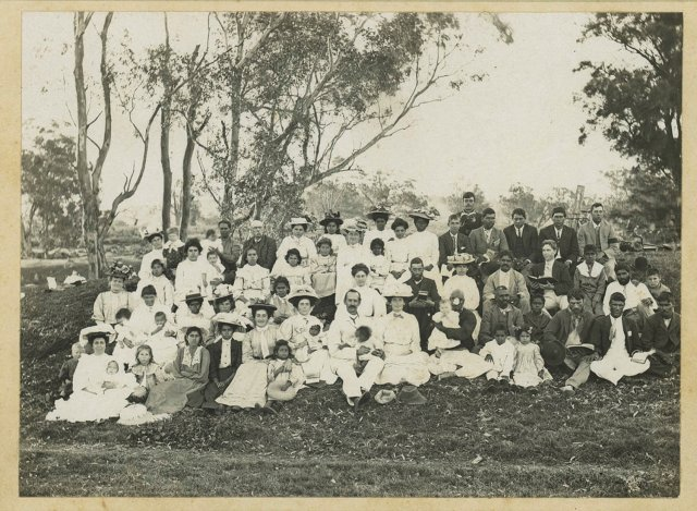 Group of Aboriginal men, women and children at Singleton, 1909. SLNSW